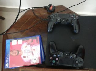 PS4 with 2 controllers and 4 cd