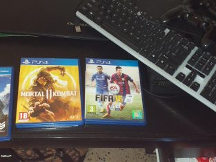 ps4 + 3 disc (mortal combat+horizan+fifa 15)  + two controllers + keyboard . only 300$