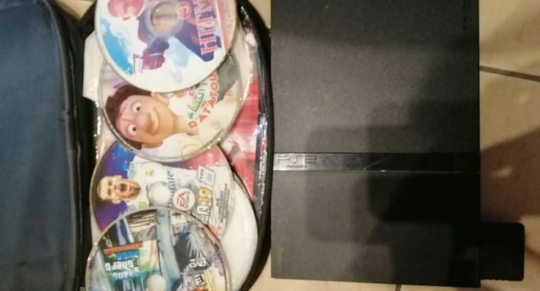 ps2 used like new with one console and cds for 45$